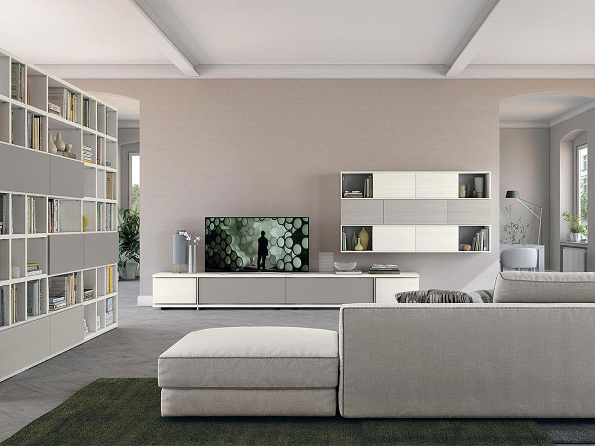 Soggiorno con libreria living arredamento mobili for Mobili per soggiorni moderni