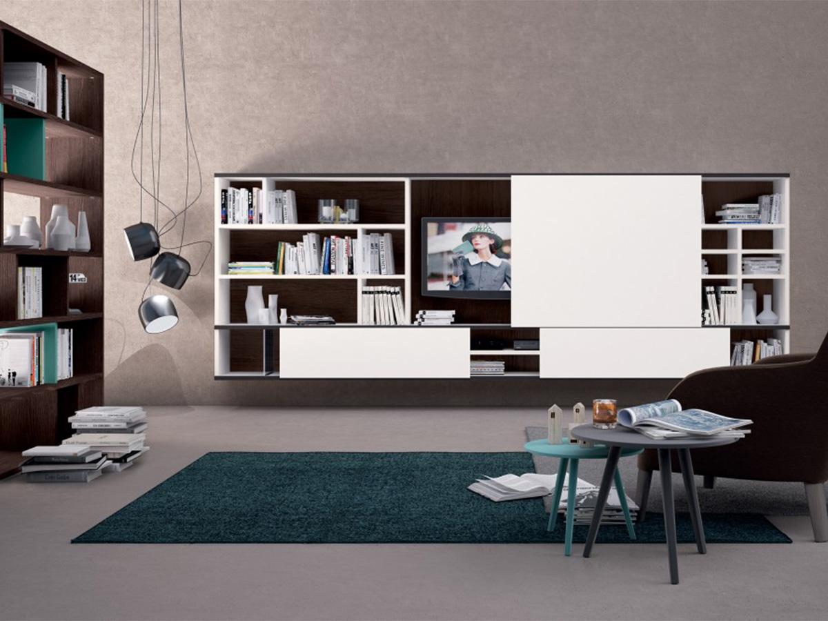Soggiorno completo con libreria divisoria arredamento for Arredamento appartamento completo